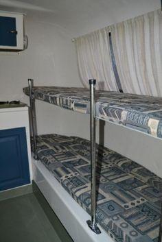 Blue white boler bunks.