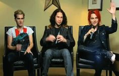 My Chemical Romance, holding up hands (I don't recall the interview, during the Danger Days tours). Mikey Way, Ray Toro, Gerard Way.