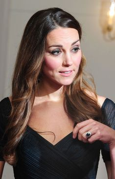 Kate Middleton's makeup was absolutely flawless and she wore her hair down in light waves.