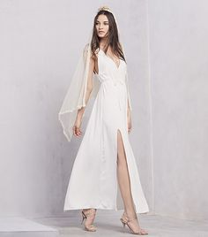 @Who What Wear - Reformation Citrine Dress ($518)  Beloved brand Reformation had bohemian brides everywhere rejoicing with the launch of their bridal collection late last month. We're particularly smitten with the Citrine Dress, a sultry maxi dress with deep V-neck and side slit.