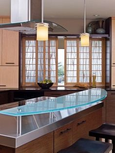 Shoji screens are a great way of bringing the outdoors inside, typical of Asian Design. Great use of different materials as well - by Sarah Henry