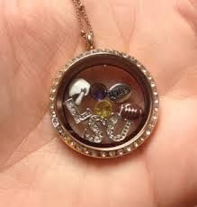 Origami Owl LSU Locket- $76 for silver ball station chain, large silver locket w/ crystals and 8 charms.  www.elizabethjenkins.origamiowl.com