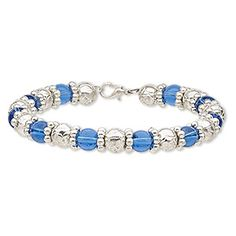 Bracelet, glass / steel memory wire / silver-coated plastic, blue, 9mm wide, 8 inches with lobster claw clasp. Sold individually.