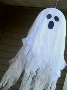 I started out with the foam discs, white cotton, cheesecloth, hot glue, fishing line and black foam.    My mom and I sat down one afternoon and created four ghosts to hang on our front porch. I covered the discs in white cotton, then a layer or two of cheesecloth. My mom strung them on fishing line then we cut strips into the fabricsto have them sway in the breeze. I cut shapes out for eyes and mouths and glued them on.