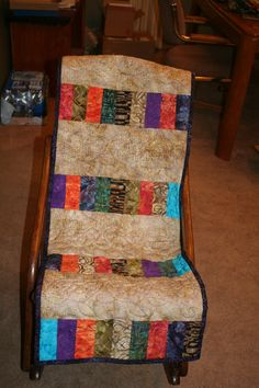 Antique Folding Rocker Chair.  Quilt made by me.