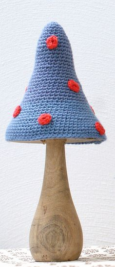 crochet mushroom ---- imagine this as a lamp instead. Wooden base and mushroom lookin' lampshade