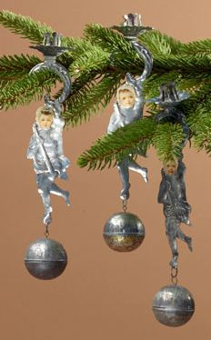 Embossed tin candle holders, draped angels with scrap paper faces and ball counterweights. Christmas ornament.
