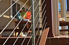 Get professional tips for selecting the best railing for your deck. Compare popular types of deck railing, including wood rails, cable rails and more. Stair Railing Kits, Metal Deck Railing, Rope Railing, Deck Railing Design, Cable Railing, Railing Ideas, Fence Ideas, Rustic Deck, Screened In Deck