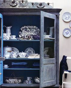 Blue and white crockery in a country cupboard