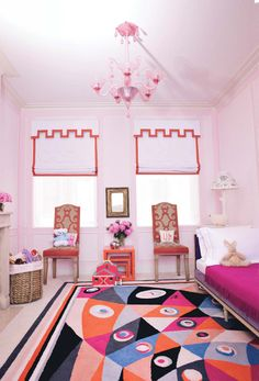 Daughter Maude\'s bedroom, with an Emilio Pucci rug, two Félix Davin chairs from 1935, and a 1940s Carlhian daybed.