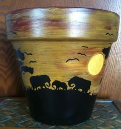 Check out this item in my Etsy shop https://www.etsy.com/listing/225506692/hand-painted-terracotta-pot-with-a