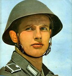 NVA soldier wearing the M56 helmet with early liner and chin strap.