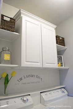 Small Laundry Room Makeover - Cabinet and Open Shelves in light grey and yellow color scheme, loads and loads of fun stencil on the wall