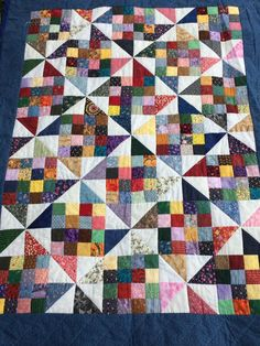 Love this scrappy quilt - simple 9 patch ½ squares and the spi . - Love this scrappy quilt – simple 9 patch ½ squares and lace – # ½ - Scrap Quilt, Scrappy Quilt Patterns, Lap Quilts, Simple Quilt Pattern, 9 Patch Quilt, Quilt Blocks, Quilting Projects, Quilting Designs, Quilting Ideas
