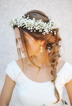 A wedding braid with a baby's breath flower crown | Brides.com