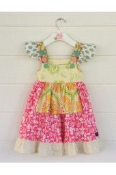 Sweet veggies anyone?  This darling dress serves up delicious girly details that you're sure LOVE!   www.fabulousgirlboutique.com