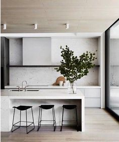 Minimalist kitchen, marble waterfall counter