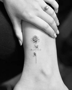 Single needle rose tattoo on the ankle.