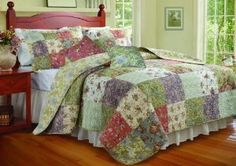 Greenland Home Blooming Prairie Twin Quilt Bonus Set :           The Blooming Prairie Bonus Quilt Set spreads a riot of garden colors across your bedroom scene. Quilt and pillow shams reverse to an all-over Jacobean print on a soft yellow ground for a truly versatile bed cover. Each fabric square is carefully seamed and quilted. Bonus s...