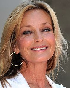 Bo Derek, 56 I don't know,,,, I had No wrinkles in 50's and i am 62 and still have no wrinkles yet,,, sun maybe??
