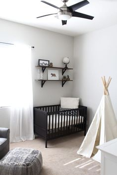 """Tribal Adventure Nursery My vision was an outdoor theme where I could implement different adventure pieces. The theme evolved into a """"Tribal Adventure Nursery"""". - We love that they did a black + white woodland + adventure nursery. Black Crib Nursery, Nursery Room, Nursery Decor, Project Nursery, Nursery Ideas, Black Nursery Furniture, Bedroom Ideas, Bed Room, Baby Boy Rooms"""