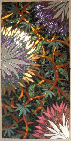 "Titled ""Flora and Fauna"" ...This is an all hand cut, handmade mosaic Stained Glass wall hanging...It is my interpretation of a ""Tropical paradise"". I have used several types of glass in this piece, including Van Gogh Glass, which is a type of glass with a metallic paint on the underside. It is 12"" X 24"""
