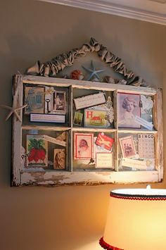 Love this! Pictures and mementos affixed to the glass. Would love to do this in a sewing theme with grandma's old sewing notions for a someday craft room!
