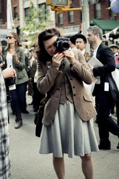 That does it: I'm buying a tweed jacket.     And please note the 40's flare, the 40's hair, and the RED NAILS. Fantastic.