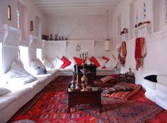 Majlis - Arab sitting room -  stark white, would swap red for aqua