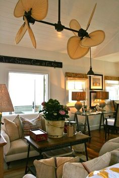 The Palisade Double Ceiling Fan adds to the British colonial flair of this beach house. The pitched ceiling allows for its large size, making the scale appropriate.