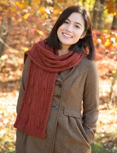 A cozy scarf with a leaf and berries motif knit in Classic Elite Yarns Inca Alpaca.