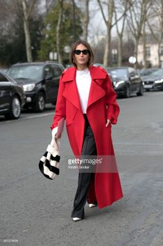 Fashion consultant and blogger Chloé Harrouche of Loulou De Saison wears a Fur Deluxe bag, Maison Rabih Kayroux coat, Loewe trousers, Celine boots, Adam Selman for Le Specs sunglasses day 2 of Paris Womens Fashion Week Spring/Summer 2018, on February 27, 2018 in London, England.