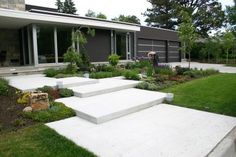 repetition of rectangles is very attractive.  I love this for the front yard, with a bit of a landing pad for people to enter the walkway. Could also add a step down and a seating area to the side.