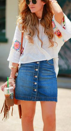 Easy spring weekend outfit with crochet flowy top, denim button up skirt, and lace up sandals