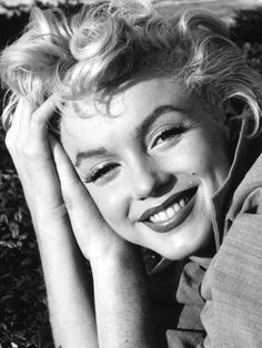 "I don""t mind living in a man's world as long as I can be a woman in it. - Marilyn Monroe"