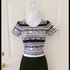 American Apparel Aztec Crop Top Black and white short sleeve crop top with Aztec pattern from American Apparel.  This top is brand new, but it was bought online, so it does not have store tags. Size small. *Please note: There is a rip in the seam near the right shoulder, as pictured.  Easily repaired! :) American Apparel Tops Crop Tops