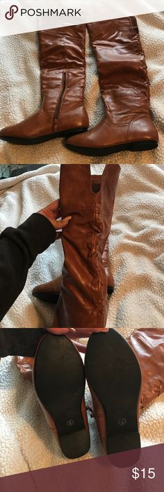 Tan knee high boots Gently worn! Cute cross detail in the back! Comfy! Zipper on the side Shoes Winter & Rain Boots