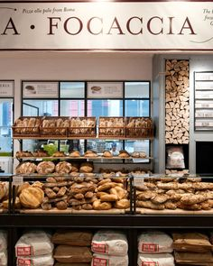 """What's Most Exciting at the Massive New Eataly  - The bread bakery, of course, is quite impressive. Everything's baked on premise in a wood-fired oven, and beyond the usual loaves, there's sweet and savory focaccia, plus Roman-style pizza alla pala. Eataly's using a 35-year-old mother yeast to make """"Pane Mediterraneo,"""" a special loaf with rye and whole-wheat flours and seven different grains and seeds. Bread Display, Bakery Display, Bakery Shops, Bakery Cafe, Bakery Shop Design, Cafe Design, Design Design, Kid Furniture, Plywood Furniture"""