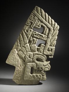 A mayan skull hacha, or axe, carved from basalt stone. Mexico, circa 600 - 900 CE — the late Classic Period.