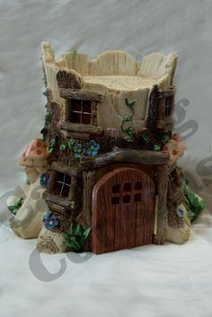 Stump House Hidden Cache Container by CachingCousins on Etsy.  So neat!