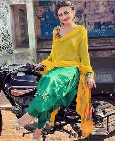 Image may contain: 2 people, people sitting and motorcycle Patiala Suit Designs, Kurti Designs Party Wear, Kurta Designs, Designer Punjabi Suits, Indian Designer Outfits, Indian Outfits, Stylish Girls Photos, Stylish Girl Pic, Stylish Boys