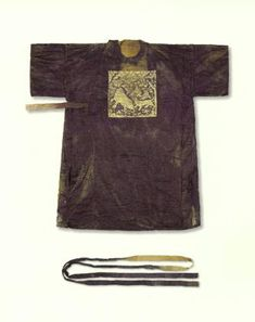This official robe was excavated from the tomb of Mrs. Yu, located in Ansong City, Gyeonggi Province. The body of the robe, and belt, is of plain silk, with two embroidered rank badges on the front and back displaying a puma and a  tiger. Dated to the 16th century, it was donated in 2004 to the Gyeonggi Provincial Museum by the Jinjoo Yu clan. Via the Virtual Collection of Asian Masterpieces.
