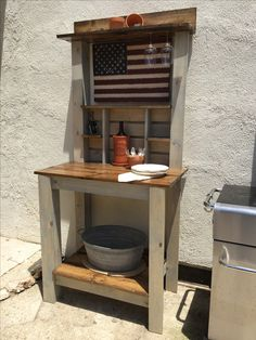 the potting bench becomes a BBQ beverage bar, just by changing the accessories.