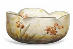 A DAUM ENAMELLED GLASS BOWL  CIRCA 1910  The quatrelobed vessel acid-etched in relief and painted in enamels with flowers and leaves, signed in relief Daum Nancy with Cross of Lorraine