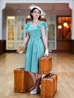 "Vintage style travel in a darling gingham 1940s dress.  It looks like it belongs in the 1940s ""State Fair""!"