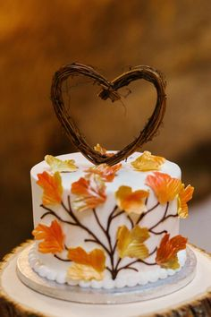 colorful wedding cakes fall wedding cakes small white with gold leaves and brunches in form of heart on top la candella weddings Autumn Wedding Cakes, Fruit Wedding Cake, Fall Wedding Colors, Wedding Cake Toppers, Wedding Cupcakes, Pumpkin Wedding, Autumn Weddings, Wedding Summer, Spring Weddings