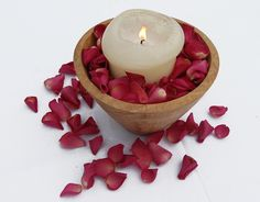 Use our Cerise Large Natural Rose Petals to create this simple candle wedding table centre piece. http://www.confettidirect.co.uk/large_natural_roses.htmls