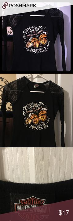 Las Vegas Harley shirt with mesh netting sleeves Woman's size small black Harley Davidson shirt with an orange butterfly on the back it says  LAS VEGAS HARLEY DAVIDSON  LAS VEGAS , Nevada.  With the logo and angel wings.  The sleeves are mesh netting. So cute !!!! Smoke free pet free home Harley-Davidson Tops