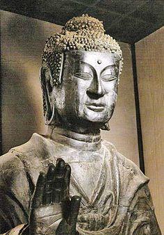 Asuka Great Buddha, seated Shakyamuni (Gautama), bronze, by Tori Busshi aka Kuratsukuri no Tori, damaged in temple fires in 887 and 1196, in Asukadera Temple, Nara, oldest surviving Buddhist statue in Japan.