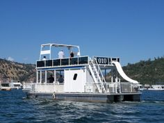 44 ft patio pontoon boat has upper deck, water slide, restroom, and is great for groups up to 15.